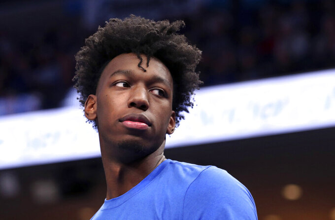 FILE - In this Wednesday, Nov. 20, 2019, file photo, Memphis' James Wiseman watches from the bench during the first half of the team's NCAA college basketball game against Little Rock in Memphis, Tenn. Wiseman says he has withdrawn from school as the likely NBA lottery pick gets ready to begin his pro career. (AP Photo/Karen Pulfer Focht, File)