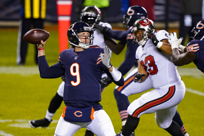 Chicago Bears quarterback Nick Foles (9) throws a pass during the first half of the team's NFL football game against the Tampa Bay Buccaneers in Chicago, Thursday, Oct. 8, 2020. (AP Photo/Nam Y. Huh)