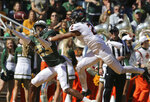 Baylor's cornerback Derrek Thomas, left, reaches for a pass intended for Oklahoma State's wide receiver Tylan Wallace, right, in the first half of an NCAA college football game, Saturday, Nov. 3, 2018, in Waco, Texas. (Rod Aydelotte//Waco Tribune-Herald via AP)