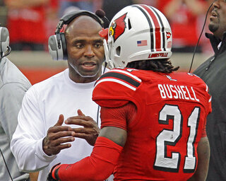 Charlie Strong, Adrian Bushell