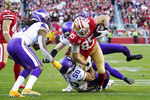 San Francisco 49ers tight end George Kittle (85) runs as Minnesota Vikings linebacker Eric Wilson (50) attempts a tackle during the second half of an NFL divisional playoff football game, Saturday, Jan. 11, 2020, in Santa Clara, Calif. (AP Photo/Tony Avelar)