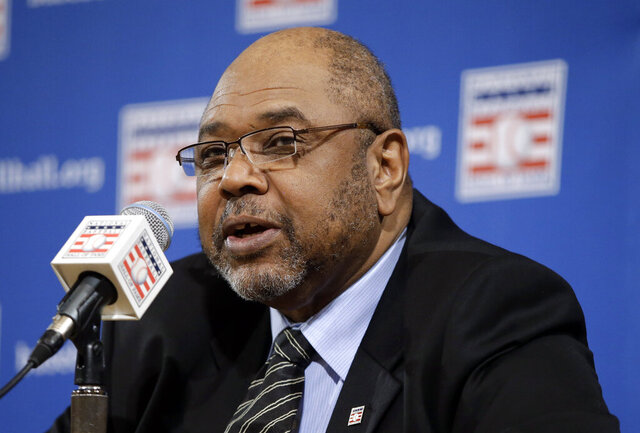 FILE - In this Dec. 3, 2012, file photo, Bob Watson talks about the selections made to the Baseball Hall of Fame by the pre-integration era committee, at the baseball winter meetings in Nashville, Tenn. Watson, a two-time All-Star as a player who later became the first African American general manager to win a World Series with the Yankees in 1996, has died. He was 74. (AP Photo/Mark Humphrey, File)