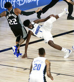 Orlando Magic forward Jonathan Isaac (1) falls to the floor after injuring his left knee in the fourth quarter of an NBA basketball game against the Sacramento Kings in Lake Buena Vista, Fla,, Sunday, Aug. 2, 2020, (Charles King/Orlando Sentinel via AP)