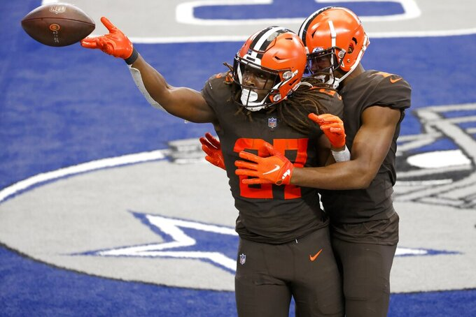 Cleveland Browns running back Kareem Hunt (27) and wide receiver Donovan Peoples-Jones, right, celebrate a touchdown scored by Hunt in the second half of an NFL football game against the Dallas Cowboys in Arlington, Texas, Sunday, Oct. 4, 2020. (AP Photo/Ron Jenkins)