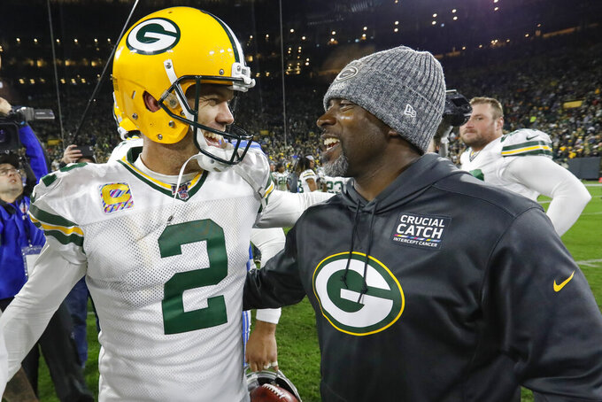 Green Bay Packers kicker Mason Crosby celebrates with a Packers coach following an NFL football game against the Detroit Lions, Monday, Oct. 14, 2019, in Green Bay, Wis. Crosby kicked the game-winning field goal in the final seconds. Green Bay won 23-22. (AP Photo/Mike Roemer)