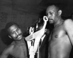 """FILE - In this April 1969 file photo, Curtis Cokes, right, weighs in for his title defense against Cuban-Mexican challenger Jose Napoles in Los Angeles. Cokes, the Hall of Fame welterweight who became Dallas' first world champion in 1966, has died. He was 82. Erwin """"Sparky"""" Sparks, Cokes' partner at the Home of Champions gym, told The Dallas Morning News that Cokes died Friday, May 29, 2020, after a week in hospice. (AP Photo, File)"""