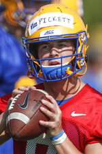 FILE - This Aug. 2, 2019, file photo shows Pittsburgh quarterback Kenny Pickett looking to pass in a drill during an NCAA college football practice in Pittsburgh. How far Pitt goes toward repeating as ACC Coastal Division champions will rely heavily on if quarterback Kenny Pickett and new offensive coordinator Mark Whipple can revive a dormant passing game.(AP Photo/Keith Srakocic, File)