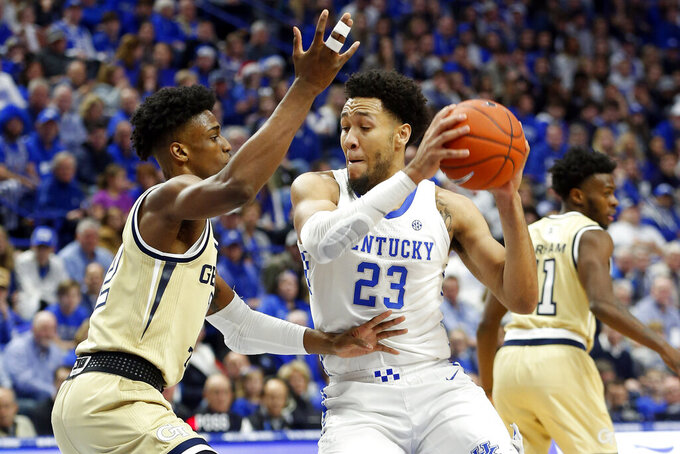 Kentucky's EJ Montgomery, right, looks for an opening on Georgia Tech's Khalid Moore, left, during the first half of an NCAA college basketball game in Lexington, Ky., Saturday, Dec. 14, 2019. (AP Photo/James Crisp)