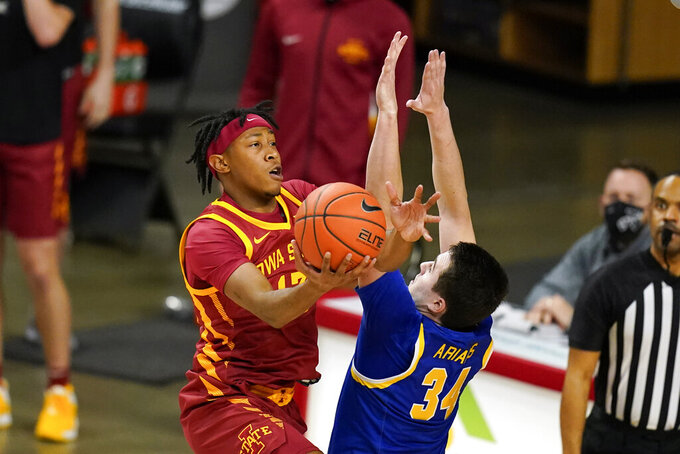 Iowa State forward Javan Johnson shoots over South Dakota State guard Alex Arians (34) during the second half of an NCAA college basketball game, Wednesday, Dec. 2, 2020, in Ames, Iowa. South Dakota State won 71-68. (AP Photo/Charlie Neibergall)