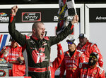 Michael Annett celebrates in Victory Lane after winning the NASCAR Xfinity series auto race at Daytona International Speedway, Saturday, Feb. 16, 2019, in Daytona Beach, Fla. (AP Photo/John Raoux)