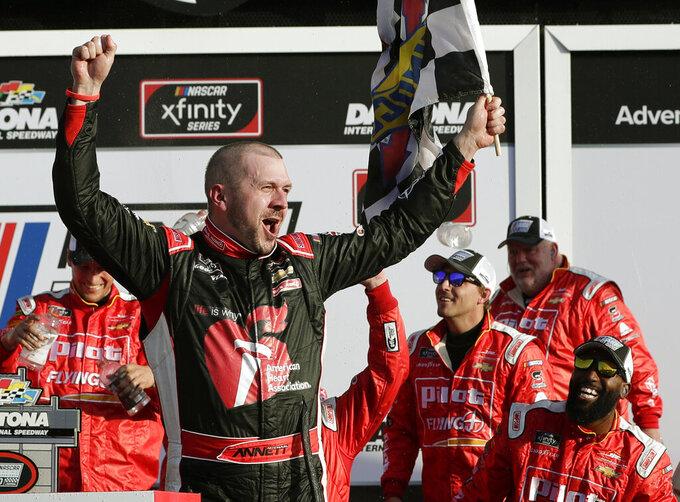 Michael Annett celebrates in Victory Lane after winning the NASCAR Xfinity series auto race at Daytona International Speedway, Saturday, Feb. 16, 2019, in Daytona Beach, Fla. (AP Photo/John Raoux)