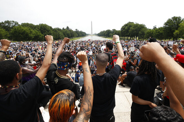 Demonstrators protest Saturday, June 6, 2020, at the Lincoln Memorial in Washington, over the death of George Floyd, a black man who was in police custody in Minneapolis. Floyd died after being restrained by Minneapolis police officers. (AP Photo/Alex Brandon)