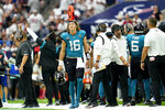 Jacksonville Jaguars quarterback Trevor Lawrence (16) walks back to the bench after throwing an interception against the Houston Texans during the second half of an NFL football game Sunday, Sept. 12, 2021, in Houston. (AP Photo/Sam Craft)