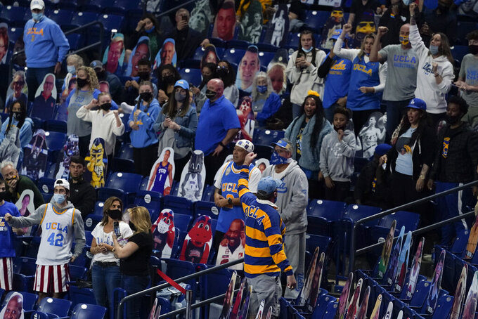 UCLA fans cheer before a men's Final Four NCAA college basketball tournament semifinal game against Gonzaga, Saturday, April 3, 2021, at Lucas Oil Stadium in Indianapolis. (AP Photo/Darron Cummings)