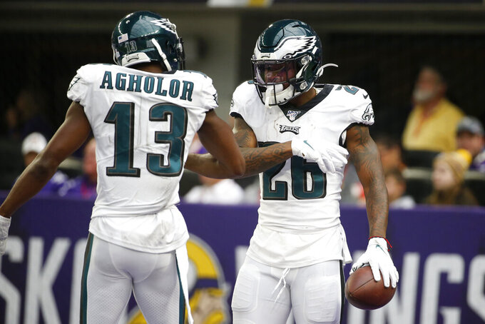 Philadelphia Eagles running back Miles Sanders celebrates with teammate Nelson Agholor, left, after catching a 32-yard touchdown pass during the first half of an NFL football game against the Minnesota Vikings, Sunday, Oct. 13, 2019, in Minneapolis. (AP Photo/Bruce Kluckhohn)