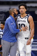 Butler head coach LaVall Jordan talks with forward Bryce Nze (10) in the first half of an NCAA college basketball game against Villanova in Indianapolis, Sunday, Feb. 28, 2021. (AP Photo/Michael Conroy)