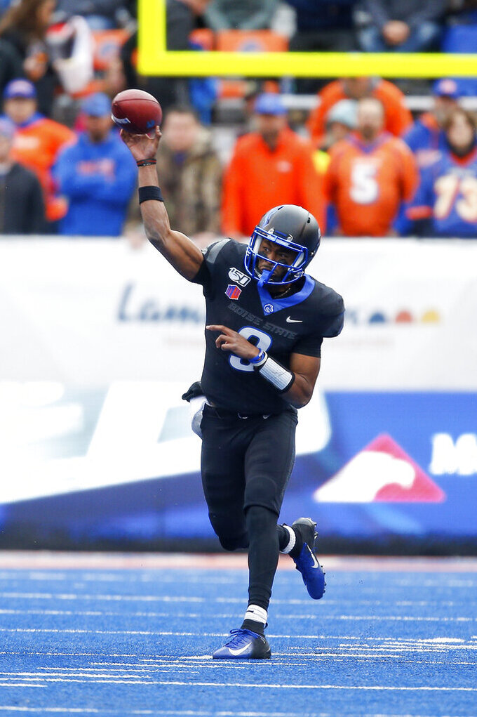Boise State quarterback Jaylon Henderson (9) throws the ball against Hawaii during the first half of an NCAA college football game for the Mountain West Championship Saturday, Dec. 7, 2019, in Boise, Idaho. (AP Photo/Steve Conner)