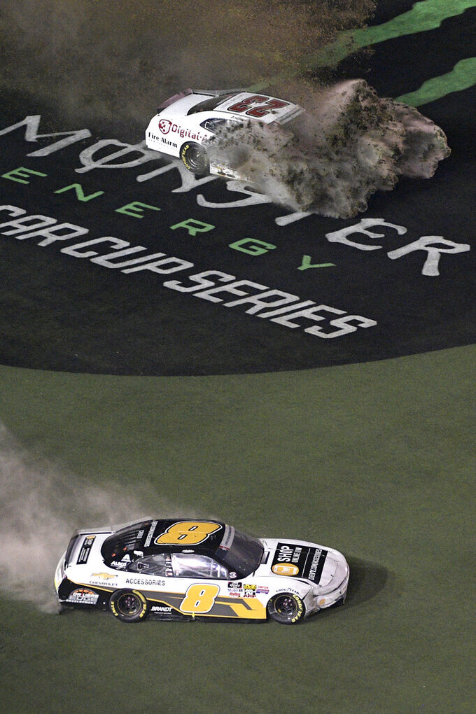 John Hunter Nemechek (23) sprays turf while sliding through the grass in front of the grandstands with Sheldon Creed (8) during the NASCAR Xfinity Series auto race at Daytona International Speedway, Friday, July 5, 2019, in Daytona Beach, Fla. (AP Photo/Phelan M. Ebenhack)