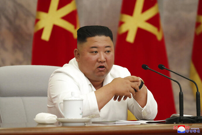 In this photo provided by the North Korean government, North Korean leader Kim Jong Un attends a Politburo meeting of the Central Committee of the Workers' Party of Korea in Pyongyang, North Korea Thursday, June 2, 2020. Independent journalists were not given access to cover the event depicted in this image distributed by the North Korean government. The content of this image is as provided and cannot be independently verified. Korean language watermark on image as provided by source reads:
