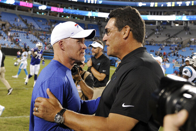 Carolina Panthers head coach Ron Rivera, right, and Buffalo Bills head coach Sean McDermott speak following an NFL preseason football game in Charlotte, N.C., Friday, Aug. 16, 2019. (AP Photo/Mike McCarn)