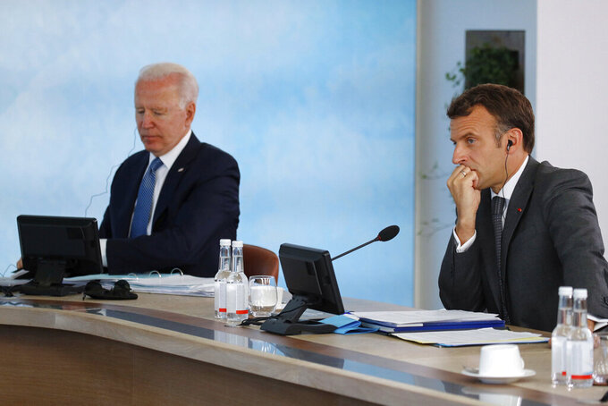 U.S. President Joe Biden, left, and French President Emmanuel Macron attend a plenary session, during the G7 summit in Carbis Bay, England, Sunday June 13, 2021. (Phil Noble/Pool via AP)