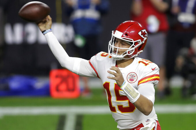 Kansas City Chiefs quarterback Patrick Mahomes (15) throws against the Las Vegas Raiders during the first half of an NFL football game, Sunday, Nov. 22, 2020, in Las Vegas. (AP Photo/Isaac Brekken)