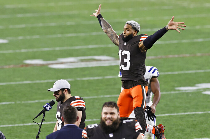 Cleveland Browns wide receiver Odell Beckham Jr. (13) jumps behind Baker Mayfield after they defeated the Indianapolis Colts in an NFL football game, Sunday, Oct. 11, 2020, in Cleveland. (AP Photo/Ron Schwane)