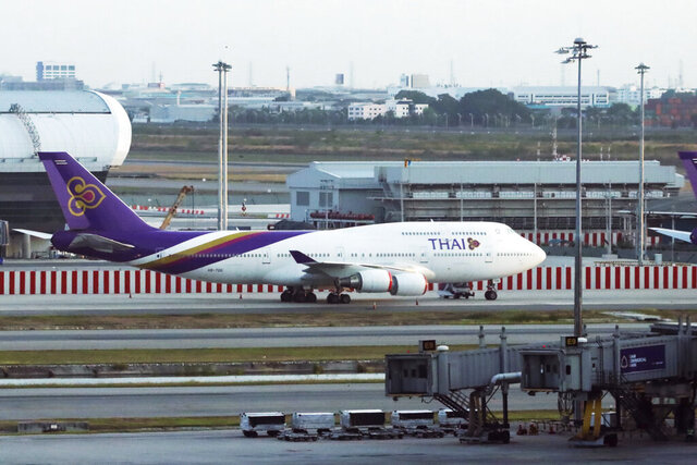 A Thai Airways jet sits on the tarmac at the Suvarnabhumi Airport in Bangkok, Thailand, Tuesday, May 19, 2020. Thailand's Cabinet has approved reducing the government's shareholding to under 50% in Thai Airways International, the nation's ailing flag carrier as part of a reorganization plan to be submitted to bankruptcy court. (AP Photo/Str)