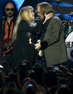 FILE - Stevie Nicks, left, and honoree Tom Petty perform