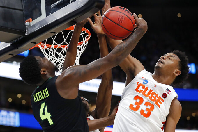 Baylor guard Mario Kegler (4) and Syracuse forward Elijah Hughes (33) vie for the ball during the first half of a first-round game in the NCAA men's college basketball tournament Thursday, March 21, 2019, in Salt Lake City. (AP Photo/Jeff Swinger)