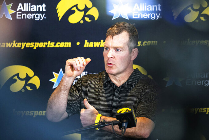 Iowa NCAA college wrestling head coach Tom Brands speaks to reporters during Hawkeyes wrestling media day, Tuesday, Jan. 5, 2021, in Iowa City, Iowa. (Joseph Cress/Iowa City Press-Citizen via AP)