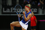 Pauline Parmentier of France reacts during the Fed Cup semifinal singles tennis match against Sloane Stephens of USA, in Aix-en-Provence, southern France, Saturday, April 21, 2018. (AP Photo/Claude Paris)