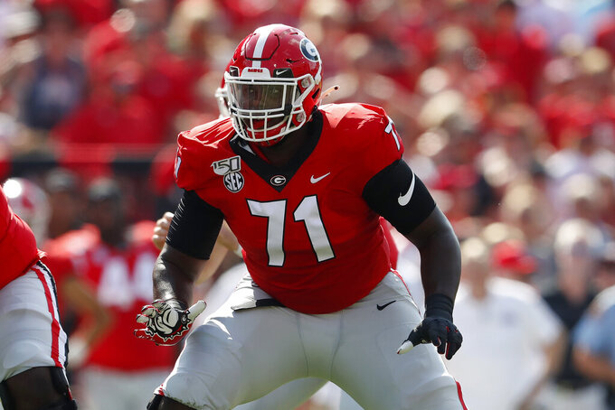 FILE - In this Sept. 7, 2019, file photo, Georgia offensive lineman Andrew Thomas (71) is shown in action during the first half of an NCAA college football game against the Murray State, in Athens, Ga. Thomas was selected to The Associated Press All-American team, Monday, Dec. 16, 2019. (AP Photo/John Bazemore, File)