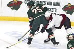 Colorado Avalanche's Joonas Donskoi, left, of Finland, tries to reach around Minnesota Wild's Jonas Brodin of Sweden for the puck in the first period of an NHL hockey game Thursday, Nov. 21, 2019, in St. Paul, Minn. (AP Photo/Jim Mone)