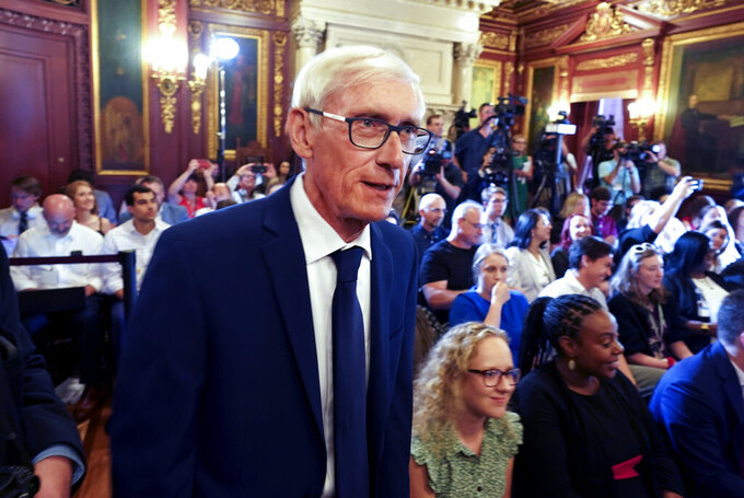 FILE - In this July 3, 2019, file photo, Wisconsin Gov. Tony Evers arrives to sign the budget at the State Capitol in Madison. How much and what taxes to cut is one of the largest remaining questions for the Legislature's budget-writing committee to tackle this week as it nears the end of its work writing the state budget. The Republican-controlled panel hopes to complete its work on Thursday, June 17, 2021. (Steve Apps/Wisconsin State Journal via AP, File)