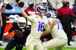 Los Angeles Rams quarterback Jared Goff (16) throws as Arizona Cardinals outside linebacker Haason Reddick (43) pursues during the first half of an NFL football game, Sunday, Dec. 6, 2020, in Glendale, Ariz. (AP Photo/Rick Scuteri)