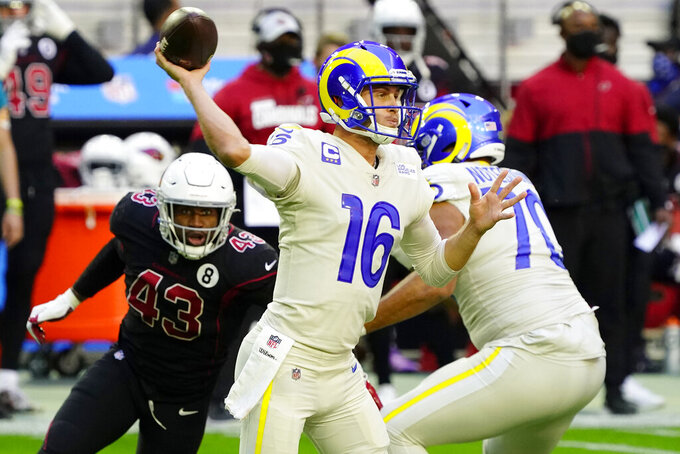Los Angeles Rams quarterback Jared Goff (16) throws as Arizona Cardinals outside linebacker Haason Reddick (43) pursues during the first half of an NFL football game, Sunday, Dec. 6, 2020, in Glendale, Ariz. (AP Photo/Rick Scuteri)