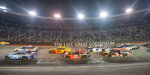 Cars drive through turns 3 and 4 during the Bass Pro Shops NRA Night Race Saturday at Brisol Motor Speedway. (David Crigger/Bristol Herald Courier via AP)