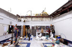 People clean up the classrooms of Benton Middle School, which lost its roof from Friday's severe weather in in Benton, La, on Saturday, Jan. 11, 2020.  Authorities say several people have died after severe storms swept across parts of the U.S. South, including an elderly couple found near their trailer home Saturday by firefighters.  (Henrietta Wildsmith/The Shreveport Times via AP)