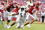 FILE - In this Oct. 19, 2019, file photo, Auburn defensive tackle Derrick Brown (5) pressures Arkansas quarterback Ben Hicks during an NCAA college football game in Fayetteville, Ark. Brown has been a play making, blockbusting force for No. 16 Auburn heading into the Iron Bowl. (AP Photo/Michael Woods, File)