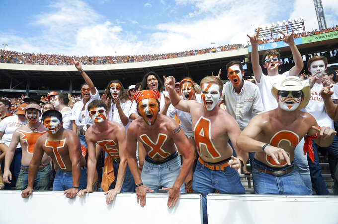 Texas fans cheer for their team against Oklahoma in the second half of an NCAA college football game at the Cotton Bowl, Saturday, Oct. 6, 2018, in Dallas. (AP Photo/Cooper Neill)