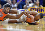 LSU guard Ja'vonte Smart, right, hits the floor going for a loose ball along with Auburn forward Anfernee McLemore, left, in the first half of an NCAA college basketball game, Saturday, Feb. 9, 2019, in Baton Rouge, La. (AP Photo/Bill Feig)
