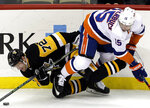 Pittsburgh Penguins' Patric Hornqvist (72) collides with New York Islanders' Cal Clutterbuck (15) during the first period of an NHL hockey game in Pittsburgh, Thursday, Dec. 6, 2018. (AP Photo/Gene J. Puskar)