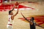 Nebraska guard Trey McGowens (2) makes a three-point basket against Purdue forward Aaron Wheeler (1) in the first half during an NCAA college basketball game Saturday, Feb. 20, 2021, in Lincoln, Neb. (AP Photo/John Peterson)