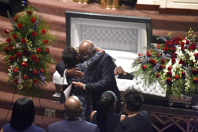 House Majority Whip Jim Clyburn hugs a relative after pausing at the casket of his wife, Emily, during her funeral services on Sunday, Sept. 22, 2019, in West Columbia, S.C. (AP Photo/Meg Kinnard)