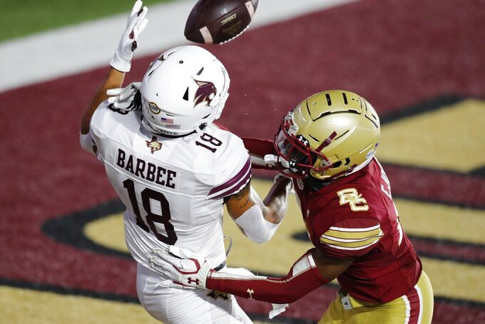 Texas State wide receiver Marcell Barbee (18) makes a touchdown reception against Boston College defensive back Elijah Jones during the first half of an NCAA college football game Saturday, Sept. 26, 2020, in Boston. (AP Photo/Michael Dwyer)