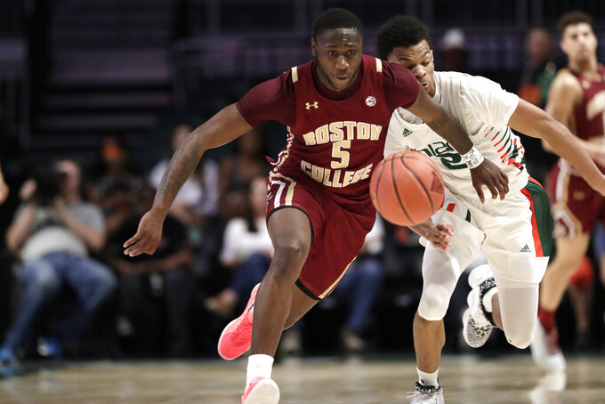 Boston College guard Jay Heath (5) and Miami guard Isaiah Wong (2) go for the ball during the second half of an NCAA college basketball game, Wednesday, Feb. 12, 2020, in Coral Gables, Fla. Miami won 85-58. (AP Photo/Lynne Sladky)