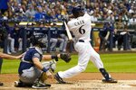 Milwaukee Brewers' Lorenzo Cain hits a home run during the third inning of a baseball game against the San Diego Padres Tuesday, Sept. 17, 2019, in Milwaukee. (AP Photo/Morry Gash)