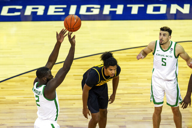 Oregon forward Eugene Omoruyi (2) shoots a free throw against Missouri during the first half of an NCAA college basketball game, Wednesday, Dec. 2, 2020 in Omaha, Neb. (AP Photo/John Peterson)