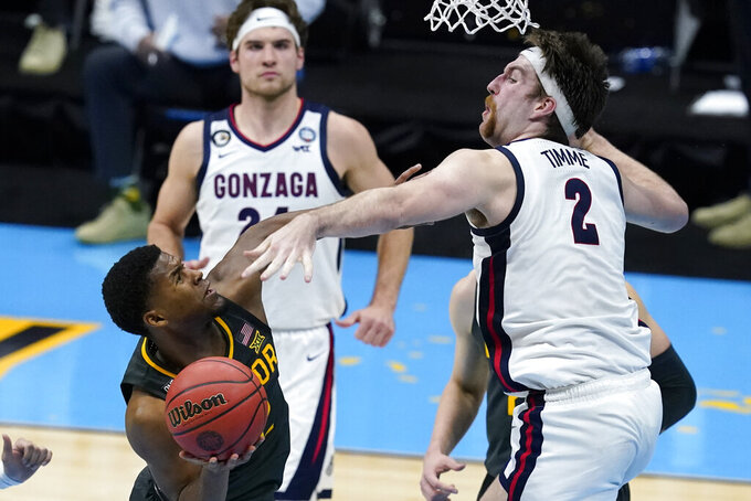 Baylor guard Jared Butler shoots over Gonzaga forward Drew Timme (2) during the second half of the championship game in the men's Final Four NCAA college basketball tournament, Monday, April 5, 2021, at Lucas Oil Stadium in Indianapolis. (AP Photo/Darron Cummings)